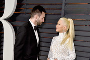Musician Matthew Rutler (L) and recording artist Christina Aguilera attend the 2015 Vanity Fair Oscar Party hosted by Graydon Carter at Wallis Annenberg Center for the Performing Arts on February 22, 2015 in Beverly Hills, California.