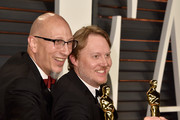 Producer Roy Conli (L) writer/director Don Hall attend the 2015 Vanity Fair Oscar Party hosted by Graydon Carter at Wallis Annenberg Center for the Performing Arts on February 22, 2015 in Beverly Hills, California.