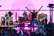 Musicians Jonny Buckland, Will Champion, Chris Martin and Guy Berryman of Coldplay perform onstage at the 2015 iHeartRadio Music Festival at MGM Grand Garden Arena on September 18, 2015 in Las Vegas, Nevada.