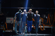 (L-R) Musicians Jonny Buckland, Will Champion, Chris Martin and Guy Berryman of Coldplay perform onstage at the 2015 iHeartRadio Music Festival at MGM Grand Garden Arena on September 18, 2015 in Las Vegas, Nevada.