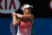 Sabine Lisicki of Germany plays a backhand in her first round match against Petra Cetkovska of Czech Republic during day two of the 2016 Australian Open at Melbourne Park on January 19, 2016 in Melbourne, Australia.