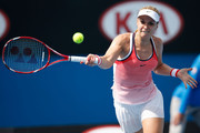 Sabine Lisicki of Germany plays a forehand in her first round match against Petra Cetkovska of Czech Republic during day two of the 2016 Australian Open at Melbourne Park on January 19, 2016 in Melbourne, Australia.