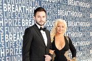 Singer/songwriter Christina Aguilera (R) and Matthew Rutler attend the 2016 Breakthrough Prize Ceremony on November 8, 2015 in Mountain View, California.