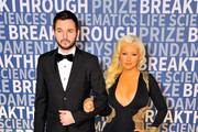 Matthew Rutler (L) and singer/songwriter Christina Aguilera attend the 2016 Breakthrough Prize Ceremony on November 8, 2015 in Mountain View, California.