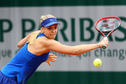 Sabine Lisicki of Germany hits a backhand during the Ladies Singles first round match against Veronica Cepede Royg of Paraguay on day two of the 2016 French Open at Roland Garros on May 23, 2016 in Paris, France.
