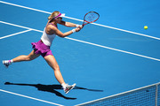 Sabine Lisicki of Germany plays a backhand to  Caroline Garcia of France in the womens singles match during day four of the 2016 Hopman Cup at Perth Arena on January 6, 2016 in Perth, Australia.