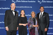 (L-R) The Jackie Robinson Foundation's Honorary Chairman of the Board, Leonard S. Coleman, Jr., Jackie Robinson Foundation President and CEO Della Britton Baeza, Jackie Robinson Foundation Founder Rachel Robinson and The Jackie Robinson Foundation's Chairman of the Board of Directors Gregg Gonsalves pose for a photo at the 2016 Jackie Robinson Foundation Awards Dinner at Marriott Marquis Broadway Ballroom on March 7, 2016 in New York City.