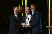 (L-R) National Academy of Recording Arts and Sciences President Neil Portnow, actor Kevin Spacey and honoree Lionel Richie pose onstage during the 2016 MusiCares Person of the Year honoring Lionel Richie at the Los Angeles Convention Center on February 13, 2016 in Los Angeles, California.