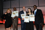 (L-R) Linda Lorence Critelli, Tim Blacksmith, Rich Christina, Charli XCX, and Trevor Gale pose with awards on stage during the 2016 SESAC Pop Music Awards on April 18, 2016 in New York City.