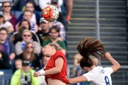 Laura Benkarth #18 of Germany jumps for a header against Jill Scott #8 England during the first half of a friend international match of the Shebelieves Cup at Nissan Stadium on March 6, 2016 in Nashville, Tennessee.