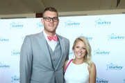 "Cole Aldrich and guest walks the red carpet at the 2016 Starkey Hearing Foundation ""So the World May Hear"" awards gala at the St Paul RiverCentre on July 17, 2016 in St Paul, Minnesota."