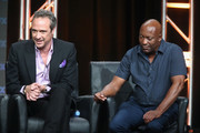 (L-R) Writer D.V. DeVincentis and director John Singleton speak onstage at 'The People v. O.J. Simpson: American Crime Story' panel discussion during the FX portion of the 2016 Television Critics Association Summer Tour at The Beverly Hilton Hotel on August 9, 2016 in Beverly Hills, California.