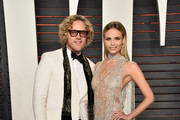 Fashion designer Peter Dundas (L) and model Natasha Poly attend the 2016 Vanity Fair Oscar Party Hosted By Graydon Carter at the Wallis Annenberg Center for the Performing Arts on February 28, 2016 in Beverly Hills, California.