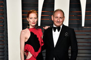 Actress Jessica Joffe and Executive Group President, The Estee Lauder Companies Inc. John Demsey attend the 2016 Vanity Fair Oscar Party Hosted By Graydon Carter at the Wallis Annenberg Center for the Performing Arts on February 28, 2016 in Beverly Hills, California.