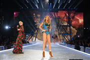 Lady Gaga and Lily Donaldson walk the runway during the 2016 Victoria's Secret Fashion Show on November 30, 2016 in Paris, France.