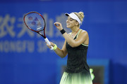 Sabine Lisicki of Germany reacts in a match against Ekaterina Makarova of Russia during Day 1 of the 2016 Wuhan Open at Optics Valley International Tennis Center on September 25, 2016 in Wuhan, China.