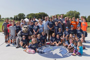 Cole Aldrich, Assistant Coach Andy Greer, John Thomas, Vice President of Community Engagement, and Crunch the Wolf of the Minnesota Timberwolves participate in the unveiling and ribbon cutting of a refurbished basketball court as part of the Timberwolves New Era. New Courts. program on August 29, 2017 at Woodlawn Park in Moorhead, Minnesota.  NOTE TO USER:  User expressly acknowledges and agrees that, by downloading and or using this Photograph, user is consenting to the terms and conditions of the Getty Images License Agreement. Mandatory Copyright Notice: Copyright 2017 NBAE