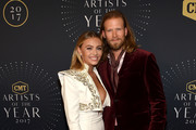 Brittney Marie Cole and Brian Kelley of Florida Georgia Line arrive at the 2017 CMT Artists Of The Year on October 18, 2017 in Nashville, Tennessee.
