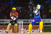 In this handout image provided by CPL T20, Shoaib Malik of Barbados Tridents hits 4 during Match 11 of the 2017 Hero Caribbean Premier League between Barbados Tridents and Trinbago Knight Riders at Queen's Park Oval on August 12, 2017 in Port of Spain, Trinidad. The keeper is Denesh Ramdin (L) of Trinbago Knight Riders.