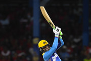In this handout image provided by CPL T20, Shoaib Malik of Barbados Tridents hits 4 during Match 11 of the 2017 Hero Caribbean Premier League between Barbados Tridents and Trinbago Knight Riders at Queen's Park Oval on August 12, 2017 in Port of Spain, Trinidad.