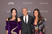 (L-R) Host Eva Chow, LACMA Trustees Michael Govan and Katherine Ross, all wearing Gucci, attend the 2017 LACMA Art + Film Gala Honoring Mark Bradford and George Lucas presented by Gucci at LACMA on November 4, 2017 in Los Angeles, California.