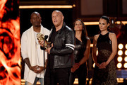 L-R) Actors Tyrese Gibson, Vin Diesel, Michelle Rodriguez, and Jordana Brewster accept the MTV Generation Award for 'The Fast and the Furious' franchise onstage during the 2017 MTV Movie And TV Awards at The Shrine Auditorium on May 7, 2017 in Los Angeles, California.