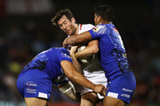 Stefan Ratchford of England is tackled by the Samoan defence during the 2017 Pacific Test Invitational match between England and Samoa at Campbelltown Sports Stadium on May 6, 2017 in Sydney, Australia.