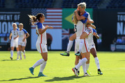 Kelley O'Hara #5, Megan Rapinhoe #15, and Becky Sauerbrunn #3 of the United States celebrate a goal against Brazil during the first half of a match in the 2017 Tournament of Nations at Qualcomm Stadium on July 30, 2017 in San Diego, California.