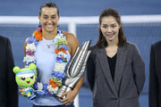 Caroline Garcia poses with former tennis player Li Na at the award ceremony after winning the ladies singles final between Ashleigh Barty of Australia and Caroline Garcia of France during Day 7of 2017 Dongfeng Motor Wuhan Open at Optics Valley International Tennis Center on September 30, 2017 in Wuhan, China.