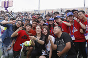Li Na of China takes a selfie with students after the tennis clinic at 2017 Wuhan Open on September 28, 2017 in Wuhan, China.