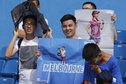 Students holds posters of Li Na of China during a tennis clinic at 2017 Wuhan Open on September 28, 2017 in Wuhan, China.