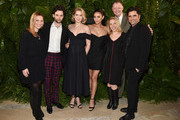 (L-R) Penn Badgley (2nd L), Elizabeth Lail, Shay Mitchell, Peter Olsen (2nd R) and John Stamos attend the 2018 A+E Upfront on March 15, 2018 in New York City.