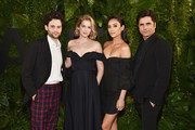 (L-R) Penn Badgley, Elizabeth Lail, Shay Mitchell, and John Stamos attend the 2018 A+E Upfront on March 15, 2018 in New York City.
