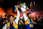 Liam Duggan and Josh Kennedy of the Eagles walks the Premiership Cup though their fans during the 2018 Toyota AFL Grand Final match between the West Coast Eagles and the Collingwood Magpies at the Melbourne Cricket Ground on September 29, 2018 in Melbourne, Australia.