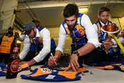 Josh Kennedy of the Eagles signs jerseys in there rooms during the 2018 Toyota AFL Grand Final match between the West Coast Eagles and the Collingwood Magpies at the Melbourne Cricket Ground on September 29, 2018 in Melbourne, Australia.