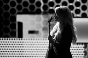 Image has been converted to black and white.)  Carrie Underwood performs onstage during the 2018 American Music Awards at Microsoft Theater on October 9, 2018 in Los Angeles, California.