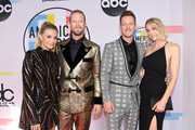 Brittney Marie Cole (L), Brian Kelley and Tyler Hubbard of Florida Georgia Line, and Hayley Hubbard attend the 2018 American Music Awards at Microsoft Theater on October 9, 2018 in Los Angeles, California.