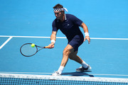 Pat Cash of Australia plays a forehand in his legend's match with Mark Woodforde of Australia against Fabrice Santoro of France and Mansour Bahrami of France on day eight of the 2018 Australian Open at Melbourne Park on January 22, 2018 in Melbourne, Australia.