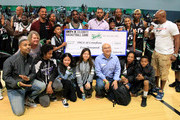 Celebrity players help present a donation to the Boys & Girls Club of America at the Celebrity Basketball Game Sponsored By Sprite during the 2018 BET Experience at Los Angeles Convention Center on June 23, 2018 in Los Angeles, California.