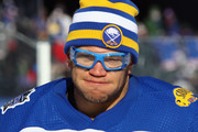 Kyle Okposo #21 of the Buffalo Sabres skates in warmups prior to the game against the New York Rangers before the 2018 Bridgestone NHL Winter Classic at Citi Field on January 1, 2018 in the Flushing neighborhood of the Queens borough of New York City. The Rangers defeated the Sabres 3-2 in overtime.