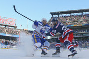 Boo Nieves #24 of the New York Rangers checks Kyle Okposo #21 of the Buffalo Sabres during the 2018 Bridgestone NHL Winter Classic at Citi Field on January 1, 2018 in Flushing neighborhood of the Queens borough of New York City, New York. The Rangers defeated the Sabres 3-2 in overtime.