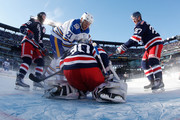 Henrik Lundqvist #30 of the New York Rangers defends his net against Kyle Okposo #21 of the Buffalo Sabres during the 2018 Bridgestone NHL Winter Classic at Citi Field on January 1, 2018 in Queens, NY.