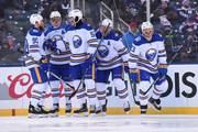 Sam Reinhart #23 of the Buffalo Sabres (R) skates toward the bench after celebrating his second period goal with teammates Ryan O'Reilly #90, Jack Eichel #15, Rasmus Ristolainen #55 and Kyle Okposo #21 during the 2018 Bridgestone NHL Winter Classic between the New York Rangers and the Buffalo Sabres at Citi Field on January 1, 2018 in the Flushing neighborhood of the Queens borough of New York City.