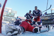 Marc Staal #18, Ryan McDonagh and Henrik Lundqvist #30 of the New York Rangers defend the net against the Buffalo Sabres during the 2018 Bridgestone NHL Winter Classic at Citi Field on January 1, 2018 in Flushing neighborhood of the Queens borough of New York City, New York. The Rangers defeated the Sabres 3-2 in overtime.