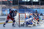 Kevin Hayes #13 passes the puck to Michael Grabner #40 of the New York Rangers for a first period goal against Robin Lehner #40 of the Buffalo Sabres during the 2018 Bridgestone NHL Winter Classic at Citi Field on January 1, 2018 in the Flushing neighborhood of the Queens borough of New York City.