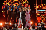 Kirk Franklin, Tori Kelly and Hillary Scott of musical group Lady Antebellum perform onstage during the 2018 CMT Artists of The Year at Schermerhorn Symphony Center on October 17, 2018 in Nashville, Tennessee.