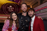 (L-R) Hillary Scott, Charles Kelley and Dave Haywood of Lady Antebellum take photos during the 2018 CMT Artists of The Year at Schermerhorn Symphony Center on October 17, 2018 in Nashville, Tennessee.
