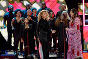 Tori Kelly(L) and Hillary Scott onstage during the 2018 CMT Artists of The Year at Schermerhorn Symphony Center on October 17, 2018 in Nashville, Tennessee.