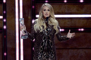 Honoree Carrie Underwood accepts an award onstage during the 2018 CMT Artists of The Year at Schermerhorn Symphony Center on October 17, 2018 in Nashville, Tennessee.