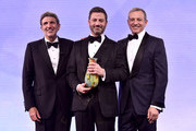 """CHLA CEO Paul Viviano and Walt Disney Company Chairman and CEO Bob Iger present the Courage to Care Award to Jimmy Kimmel onstage at the 2018 Children's Hospital Los Angeles """"From Paris With Love"""" Gala at LA Live on October 20, 2018 in Los Angeles, California."""
